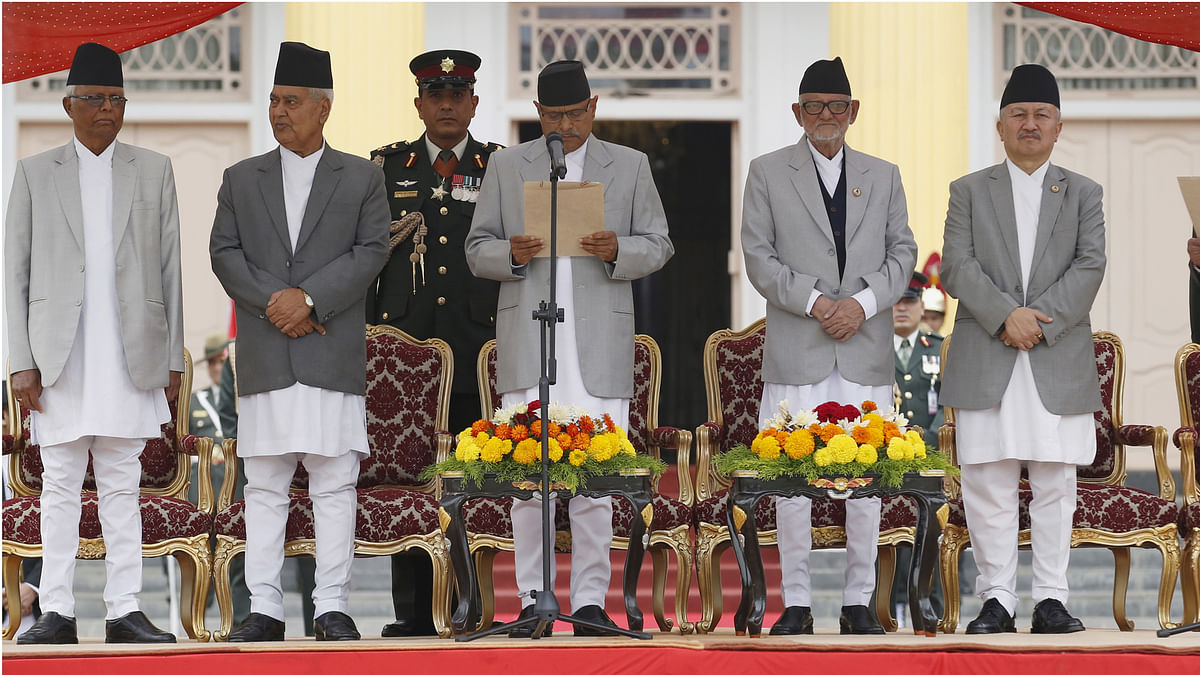 Nepal's President Ram Baran Yadav (front 3rd L) administers the oath of office to the country's newly-elected Prime Minister Khadga Prashad Sharma Oli. (Photo: Reuters)