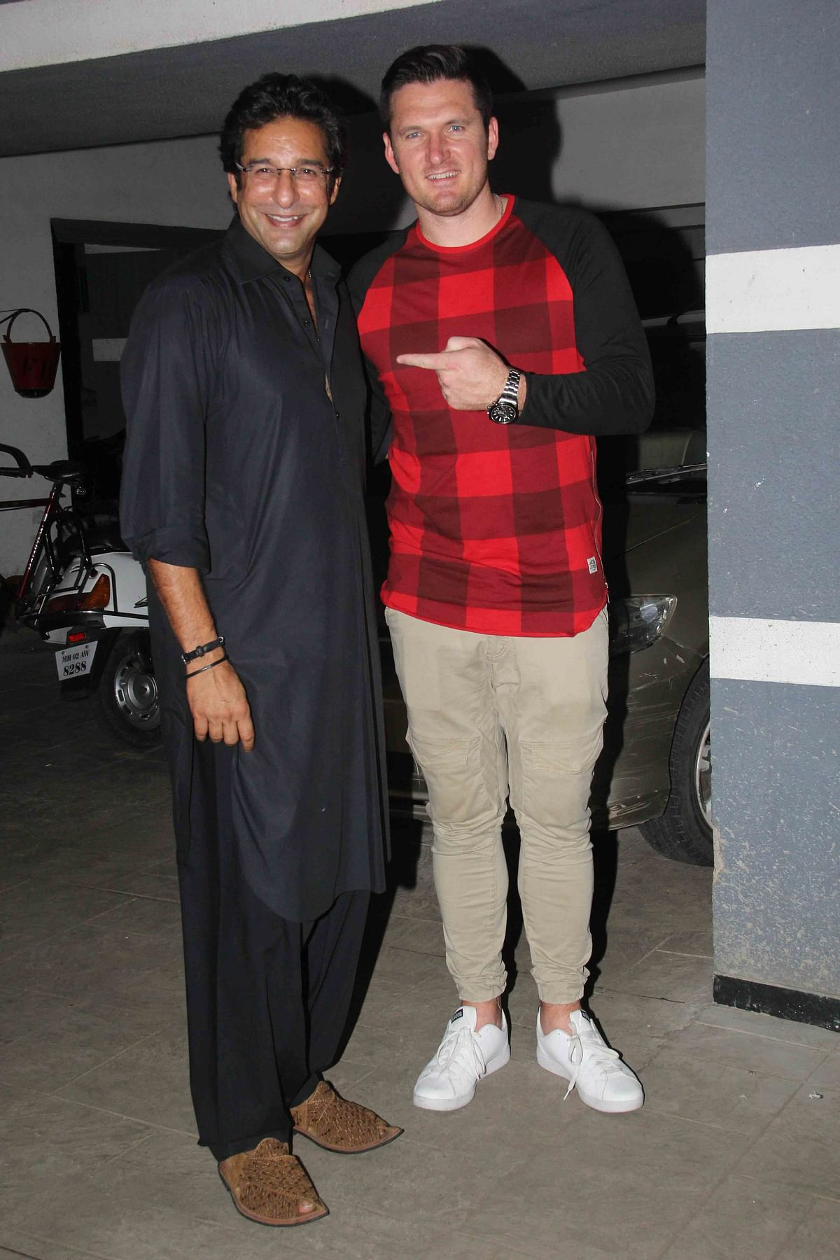 Wasim Akram and Graeme Smith pose for a picture at Sanjay Kapoor's birthday party. (Photo: Yogen Shah)