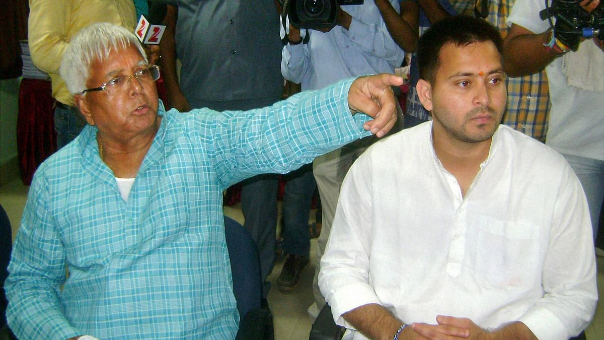 RJD chief Lalu Prasad during filing of nomination papers by his son and party candidate from Raghopur Tejashwi Yadav (R) in Hajipur, October 3, 2015. (Photo: PTI)