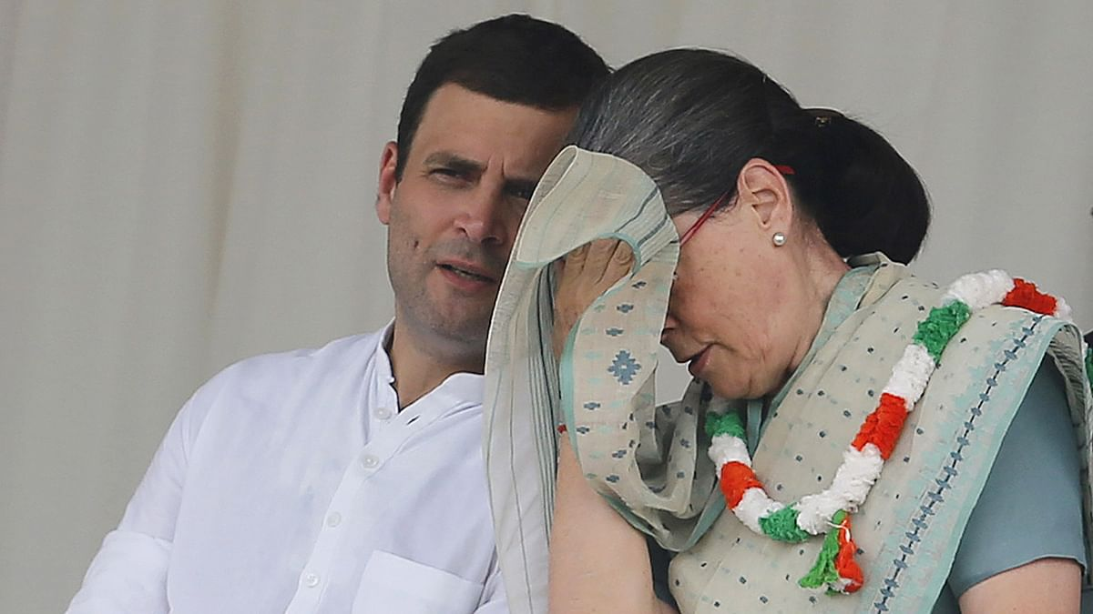 Congress party Vice President Rahul Gandhi speaks to his mother Sonia at a rally in New Delhi. (Photo: Reuters)