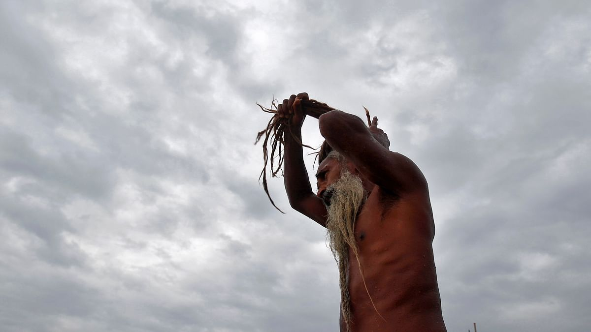 A sadhu adjusts his dreadlocks after taking a holy dip in the waters of Sangam in Allahabad. (Photo: Reuters)