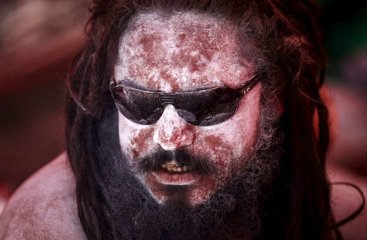 """A Naga Sadhu sits in his tent during the second """"Shahi Snan"""" (grand bath) at """"Kumbh Mela"""", or Pitcher Festival, in Trimbakeshwar, India. (Photo: Reuters)"""