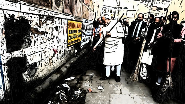Prime Minister Modi taking part in the Swachh Bharat campaign.