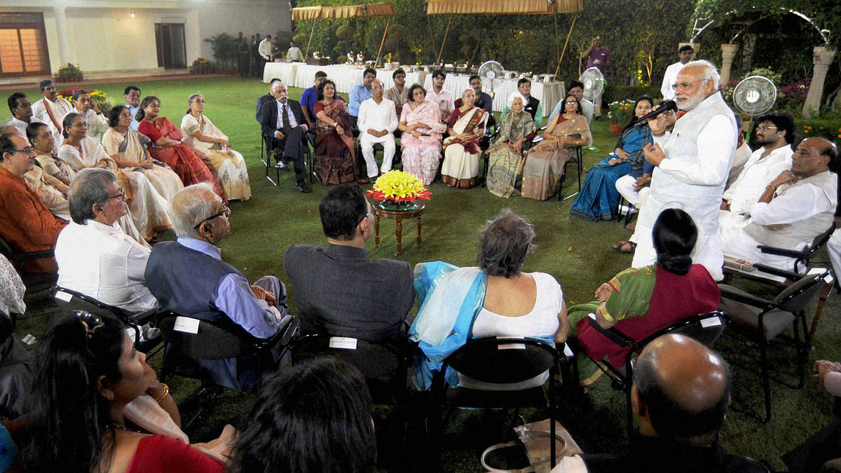 Prime Minister Narendra Modi interacting with the family members of Netaji Subhas Chandra Bose, at 7, Race Course Road, in New Delhi on Wednesday. (Photo: PTI)