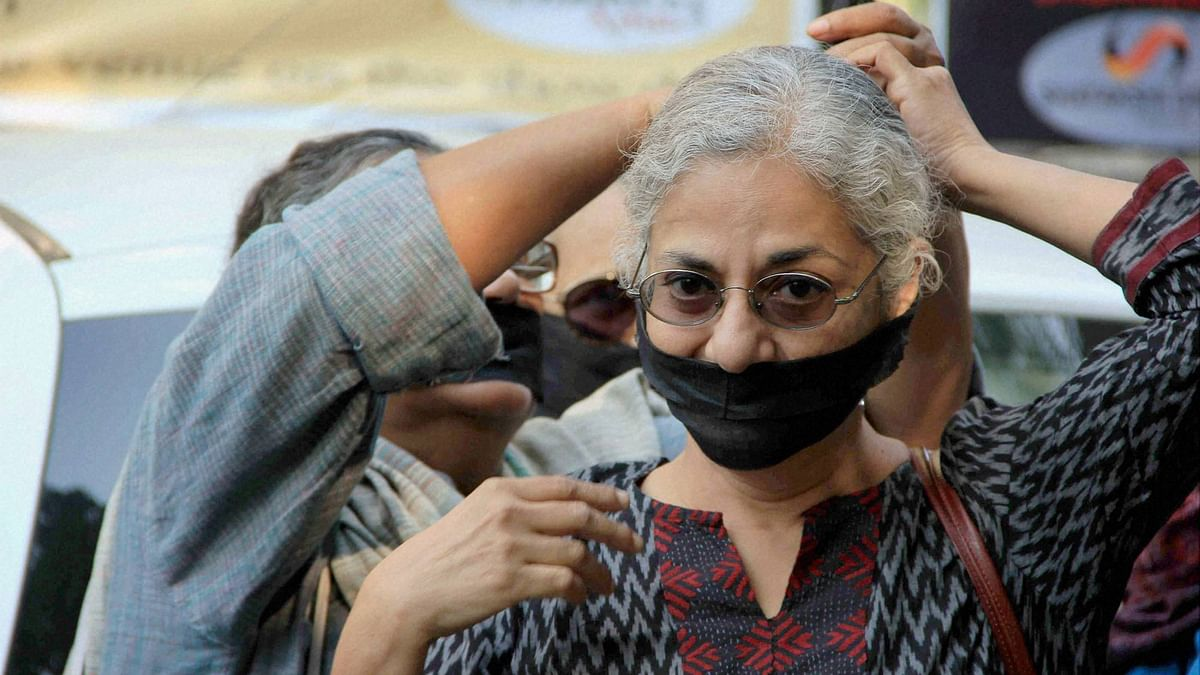 Writers and cultural activists tying black gags and arm bands at a solidarity march, ahead of an emergency meeting of the Sahitya Akademi in New Delhi on Friday. (Photo: PTI)