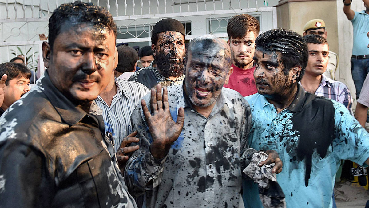 J&K MLA Abdul Rashid Sheikh's face was blackened by a few activists, allegedly belonging to a right-wing organisation, at the Press Club in New Delhi, October 19, 2015. (Photo: PTI)
