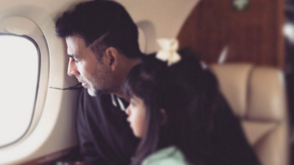 Akshay Kumar and daughter Nitara peep outside from an airplane window. (Photo: Instagram/thewhitewindow)