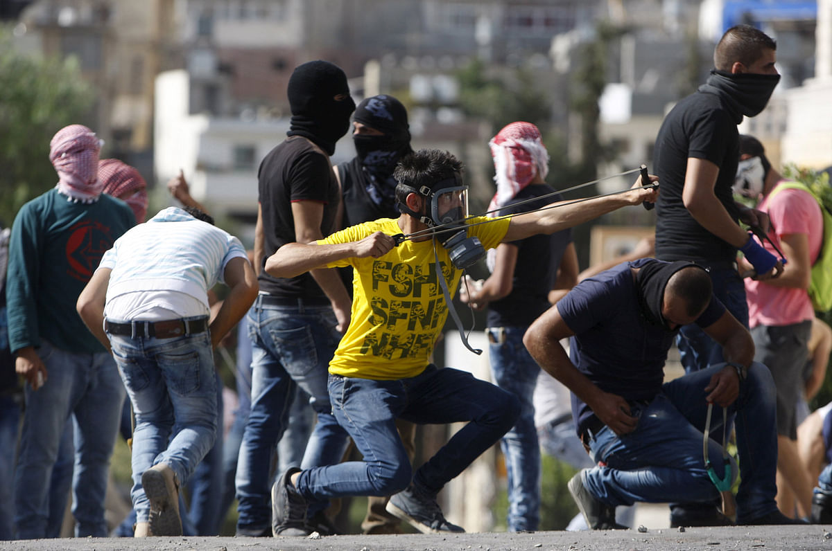 Palestinian protesters have said that Israeli cabinet decisions will not stop the <i>Intifada </i>(Photo: Reuters)