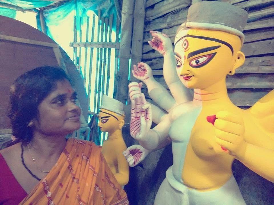 Artist China Pal with her creation, the unique ardhanarishwar Durga. (Photo Courtesy: Pratyay Gender Trust)