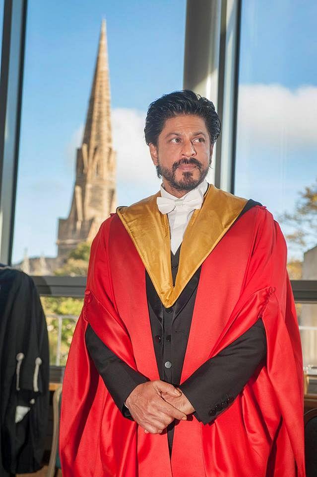 SRK stands wearing his honourable robe. (Photo: facebook/ Edinburgh University)