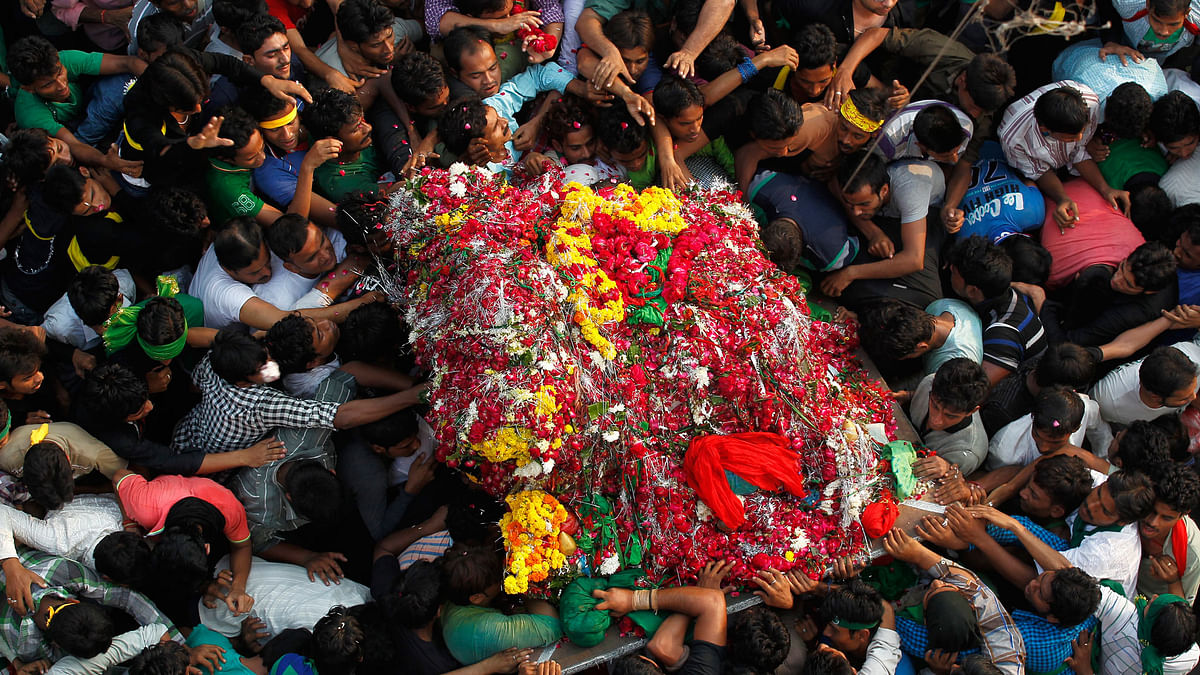 """Shi'ite Muslims carry a """"Tazia"""", or a replica of the coffin of Imam Hussein, during a Muharram procession to mark Ashura in Allahabad."""