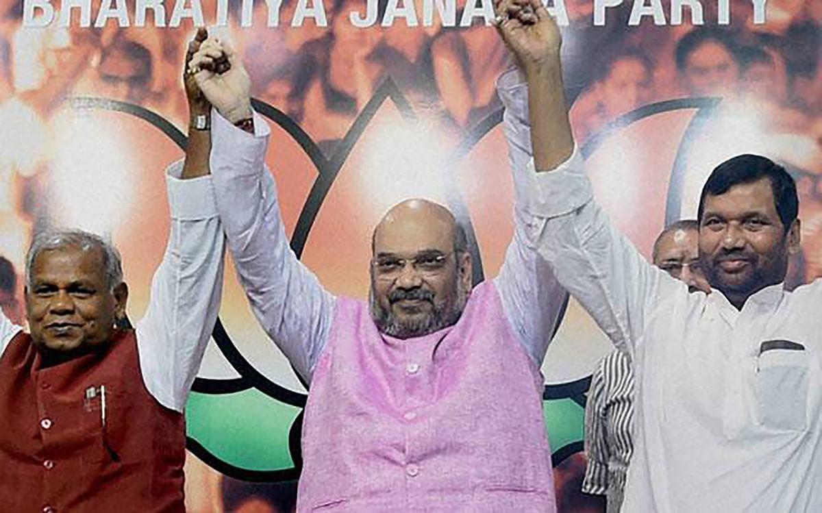 Amit Shah with Jitan Ram Manjhi (extreme left) and Ram Vilas Paswan. (Photo: PTI)