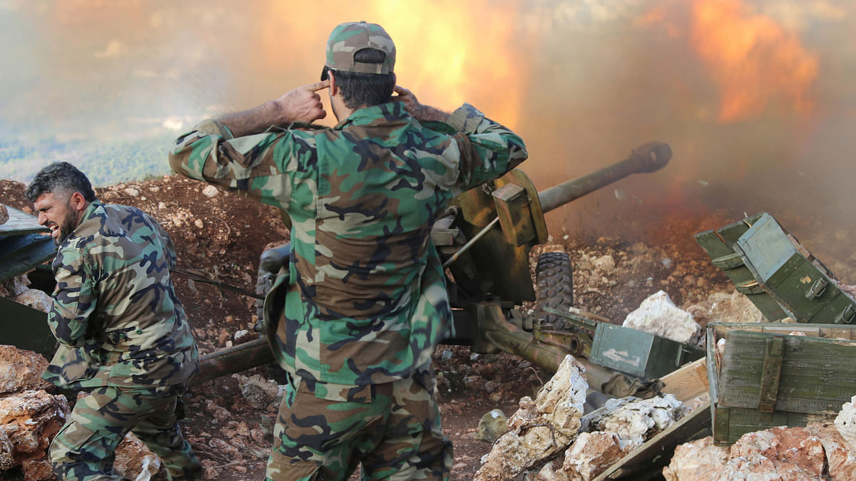 In this photo taken on Saturday, October 10, 2015, Syrian soldiers  fire a cannon in Lattakia province,  in Syria. Backed by Russian air strikes, the Syrian army has launched an offensive in central and northwestern regions of the country. (Photo: AP)