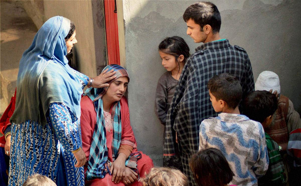 Family members of  Zahid in Kashmir. (Photo: PTI)