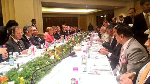 Prime Minister Narendra Modi and Chancellor Angela Merkal at an interactive session with the Indian CEOs in Bengaluru, October 6, 2015. (Photo courtesy: @MEAIndia)