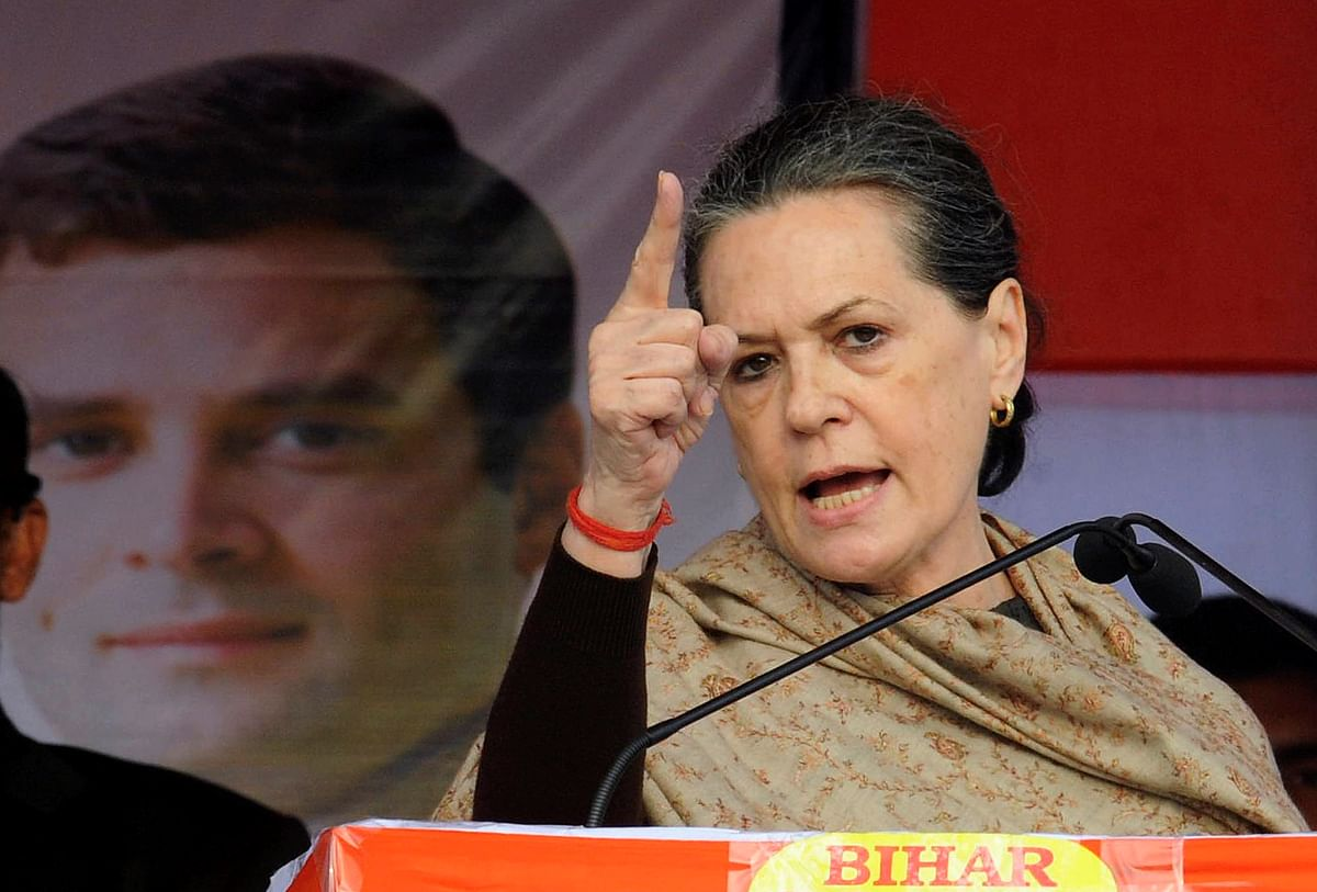 Sonia Gandhi addresses a gathering next to a portrait of her son and Congress Vice President Rahul Gandhi in Bihar. (Photo: Reuters)