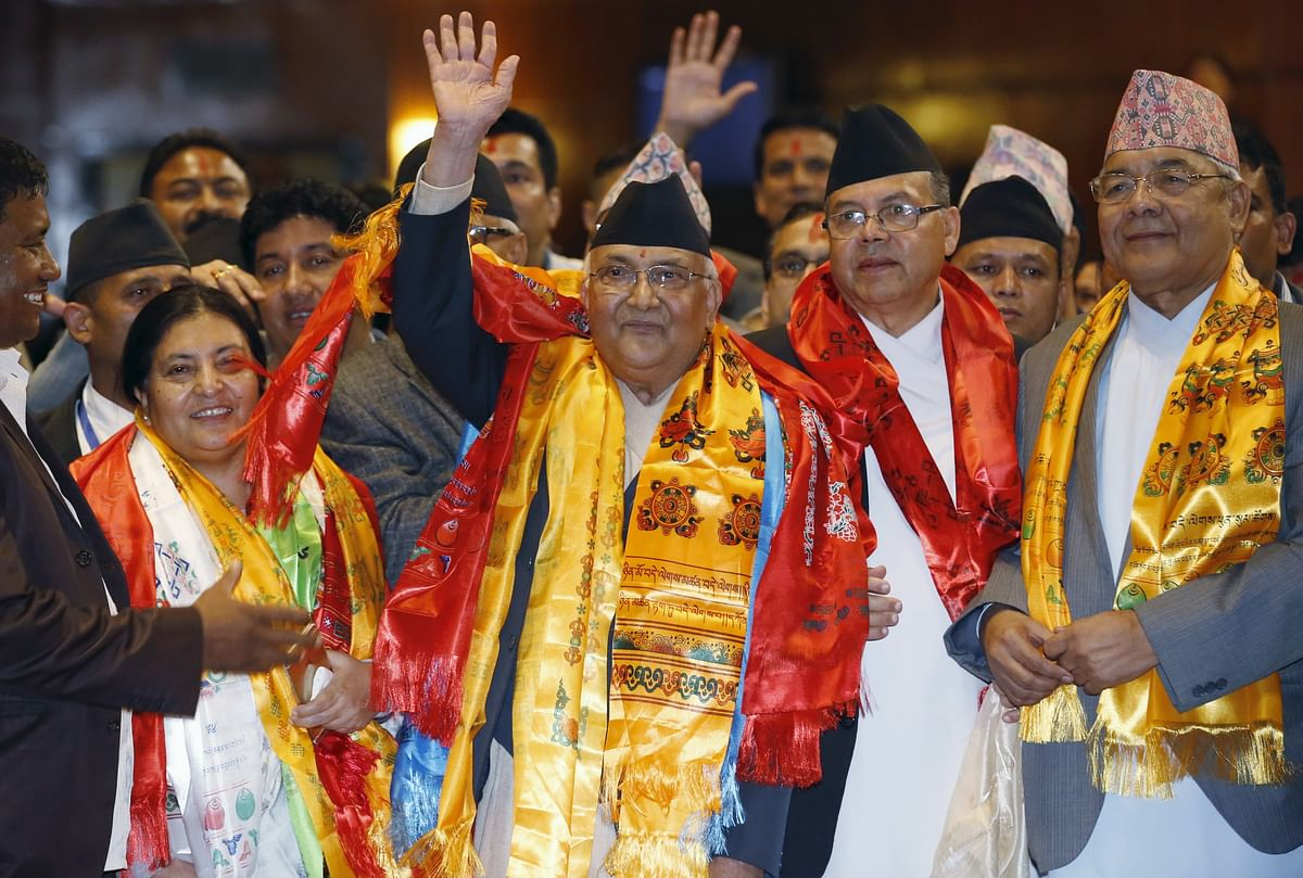 Nepal's newly-elected prime minister, Khadga Prashad Sharma Oli, also known as KP Oli (C), waves after being elected as the country's 38th prime minister.(Photo: Reuters)