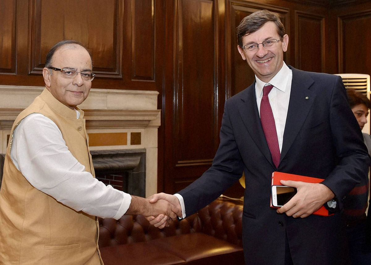 Union Minister for Finance, Corporate Affairs and Information & Broadcasting, Arun Jaitley shakes hand with Vodafone Group CEO Vittorio Colao during a meeting in New Delhi. (Photo: PTI)