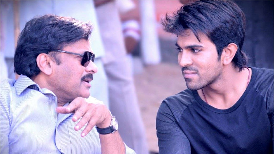 "Chiranjeevi in a deep discussiong with his son Ram Charan, in the legendary actor's comeback role in <i>Bruce Lee: The Fighter </i>(Photo: Facebook/<a href=""https://www.facebook.com/AlwaysRamCharan/photos_stream"">Always Ram Charan</a>)"