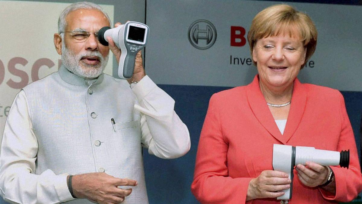 Prime Minister Narendra Modi with German Chancellor Angela Merkel at Robert Bosch Vocational Center in Bengaluru on Tuesday. (Photo: PTI)