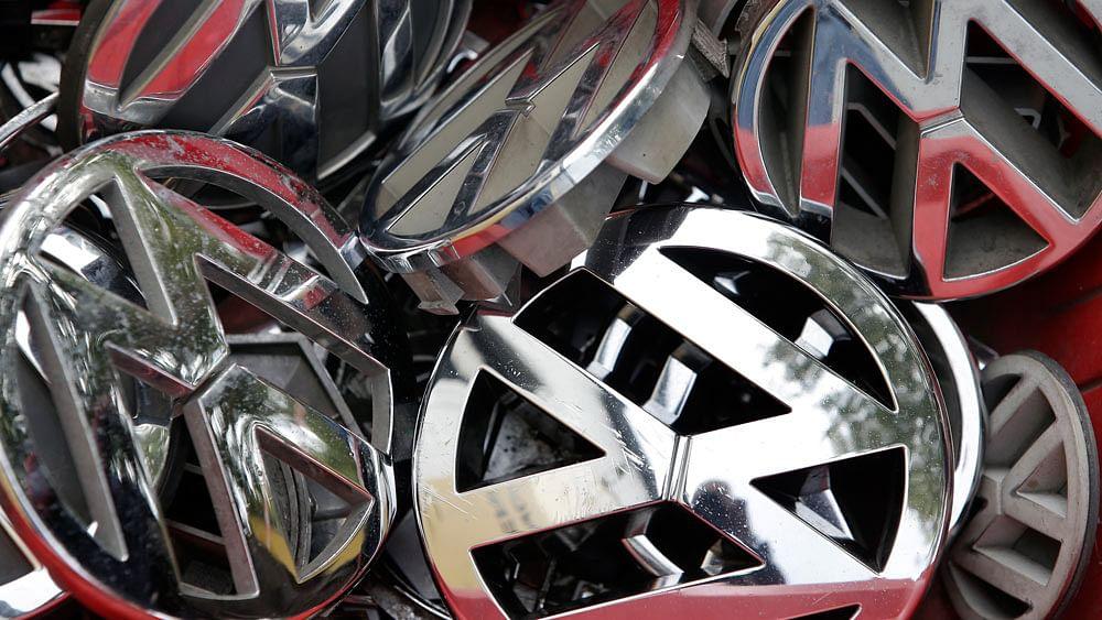 File photo of Volkswagen ornaments in a box in a scrap yard in Berlin, Germany. (Photo: AP)