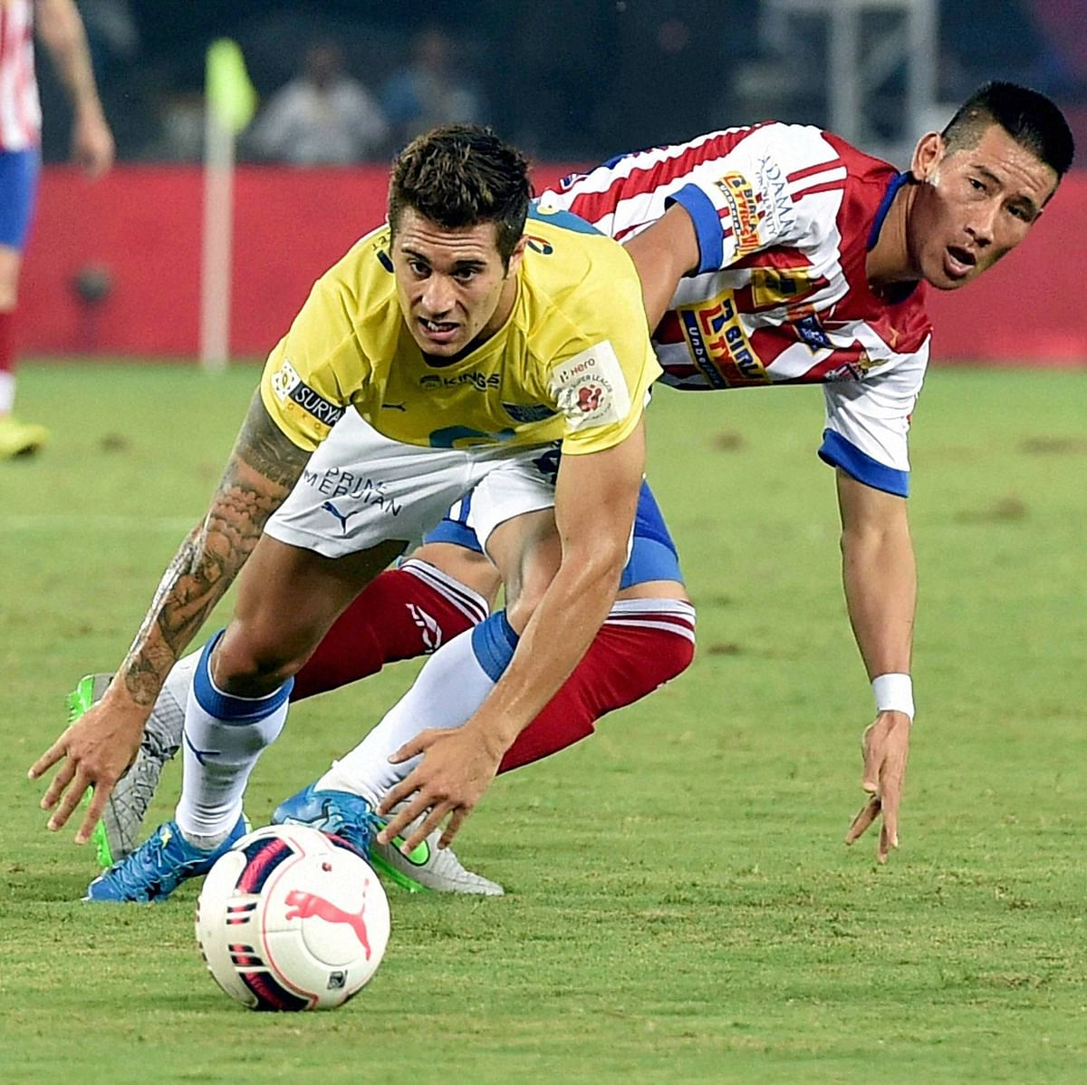 Atletico de Kolkata (red and white) and Kerala Blasters FC players in action during an ISL match in Kolkata. (Photo: PTI)
