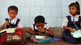 Representational image of children eating their mid-day meal in school. (Photo: Reuters)