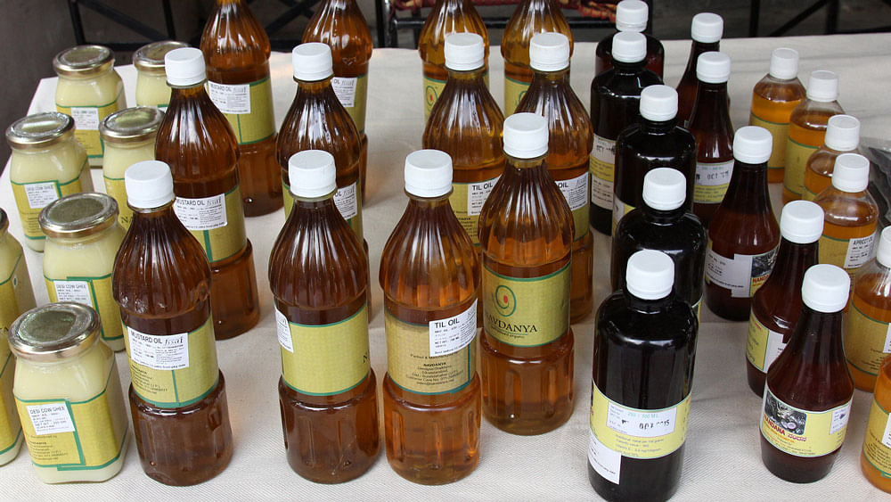 At the ongoing organic food festival at Delhi's Dilli Haat, Vandana Shiva's Navdanya is selling 700 ml of mustard oil for Rs 180 (or Rs 257 a litre). (Photo: Vivian Fernandes/<b>The Quint</b>)