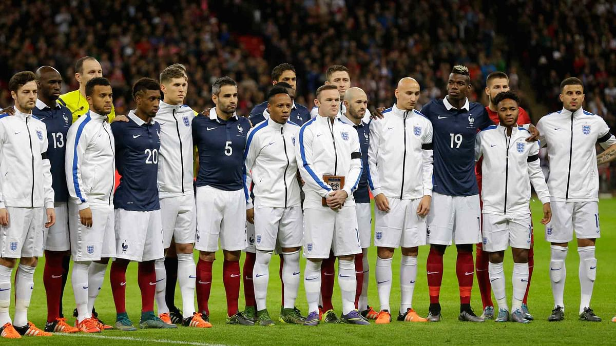 England and France players stand together as a mark of respect for the victims of Friday's attacks in Paris, before their international friendly at Wembley Stadium. (Photo: AP)