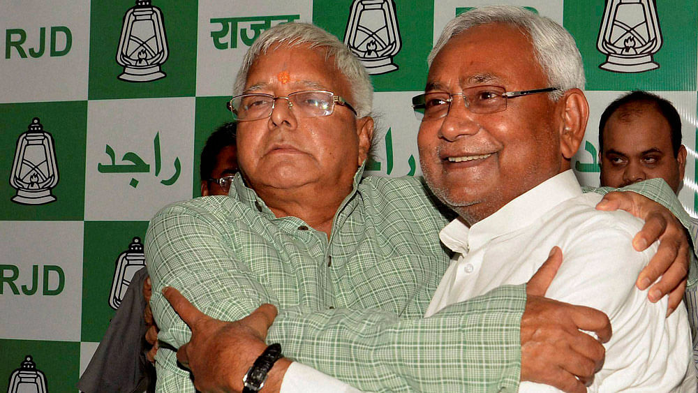 With Lalu's imprint clearly visible in the cabinet, is it a good start or beginning of an uneasy relationship in Bihar? (Photo: PTI)