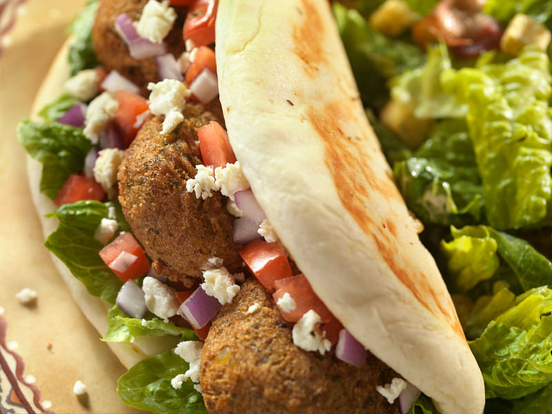 Falafel is sometimes served by itself, but it's usually served wrapped inside of a pita or tortillas.