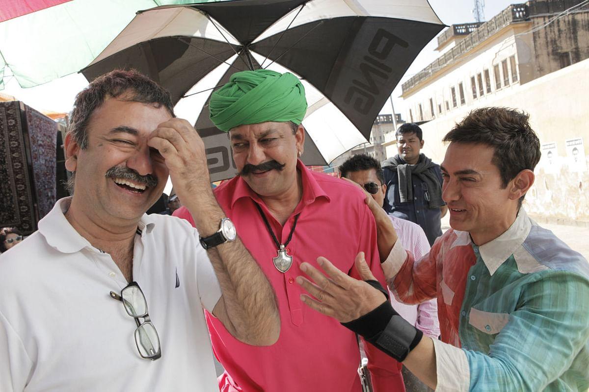 "Rajkumar Hirani, Sanjay Dutt and Aamir Khan share a joke on the sets of <i>PK</i> (Photo: Twitter/<a href=""https://twitter.com/BollywoodH"">@BollywoodH</a>)"