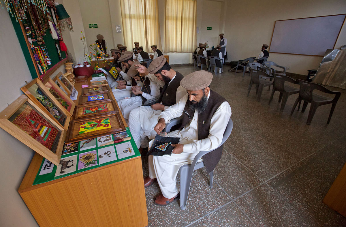Men learn to create handicrafts in a classroom at the Mashal de-radicalisation centre run by the Pakistani army in Gulibagh, Pakistan's Swat Valley. (Photo: Reuters)