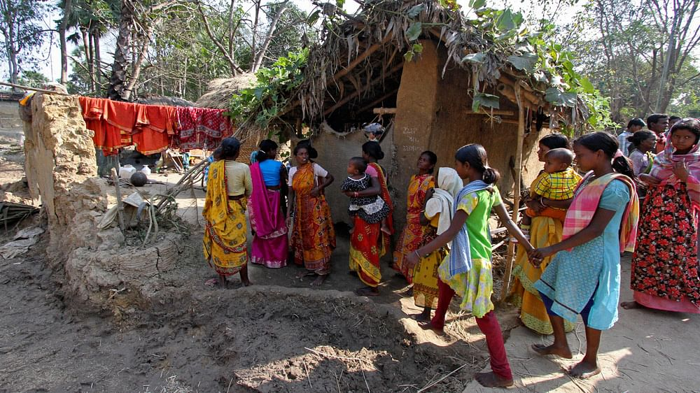 Villagers walk near the area where a woman was gang-raped by 13 men on the orders of a village court at Birbhum district, in West Bengal, January 24, 2014. (Photo: Reuters)