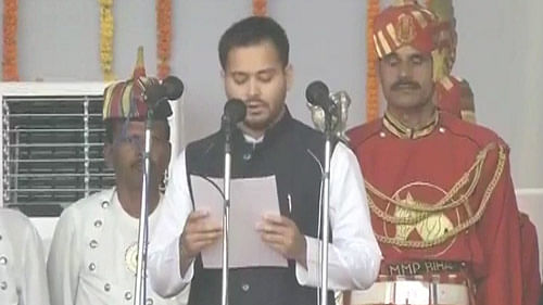 Lalu's younger son, Tejaswi Yadav taking oath at the swearing-in ceremony today. (Photo courtesy: ANI)