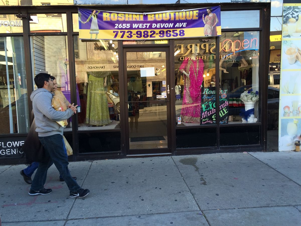 "Shopkeepers at Devon Ave scream ""Fifty percent off"" or ""Sale"" and ""Good bargains"", just like they would do in India. (Photo: Sonia Chopra)"