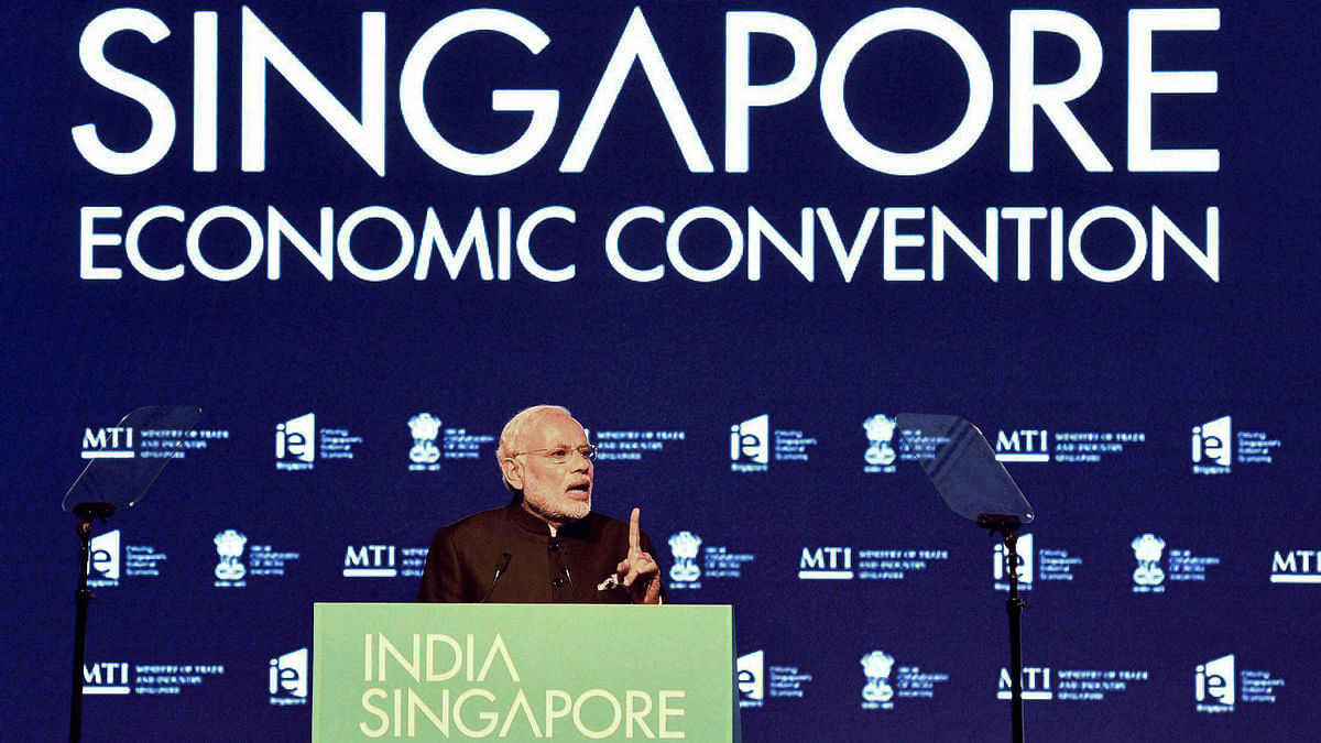 Narendra Modi addressing at the India-Singapore Economic Convention in Marina Bay Sands Convention Centre, in Singapore on Tuesday. (Photo: PTI)