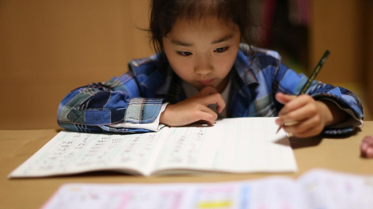 9-year-old Mahiro Takano, three-time Japan karate champion in her age group, does her school homework before going to her karate practice in Nagaoka, Niigata Prefecture, north of Tokyo. (Photo: AP)