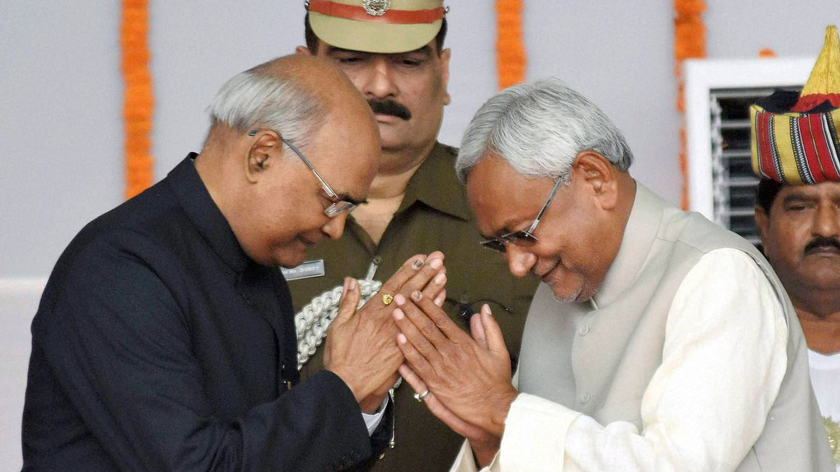 Nitish Kumar greets Governor Ram Nath Kovind after taking oath as the Chief Minister of Bihar during the swearing-in ceremony at Gandhi Maidan in Patna on Friday. (Photo: PTI)