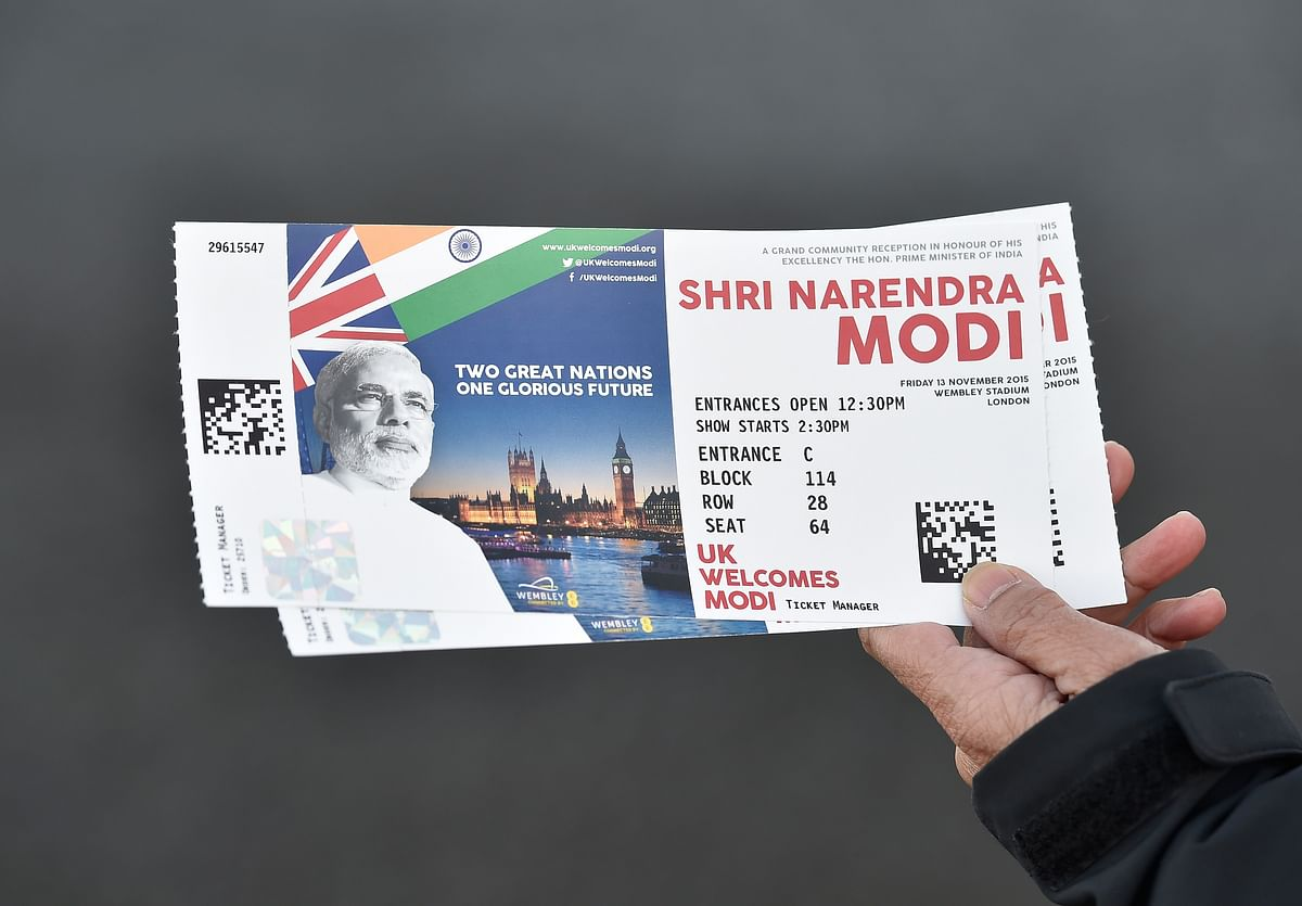A man shows off his tickets on his way to Wembley Stadium. (Photo: Reuters)