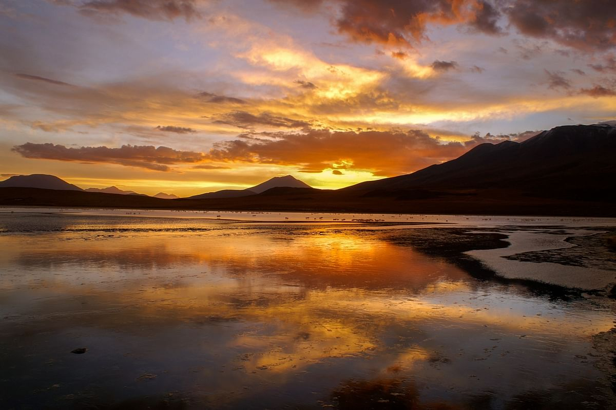 Sunset at Laguna Canapa, dotted with flamingoes in southwestern Bolivia. (Photo Courtesy: Jay Kannaiyan)