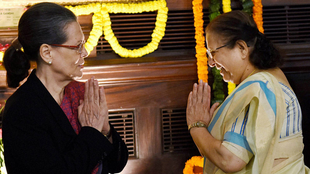 Lok Sabha Speaker Sumitra Mahajan greets Congress President Sonia Gandhi after paying tributes to former Prime Minister Indira Gandhi, November 19, 2015. (Photo: PTI)