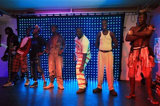 Contestants stand on stage, during the 2015 edition of the Mr Ugly competition, in Harare. (Photo: AP)