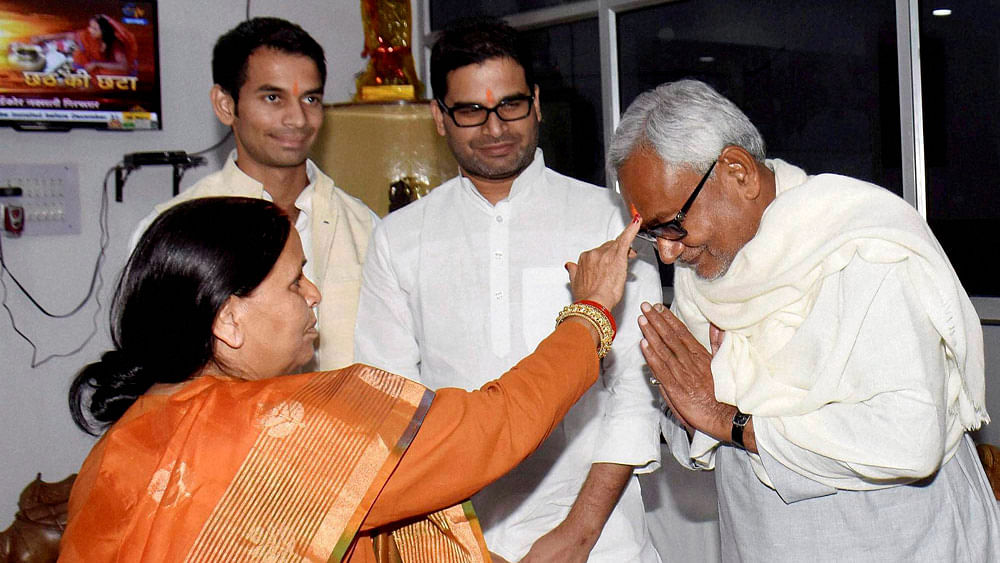 RJD leader Rabri Devi applying tika to the incoming Bihar Chief Minister Nitish Kumar  during Chhath festival in Patna, November 16, 2015. (Photo: PTI)