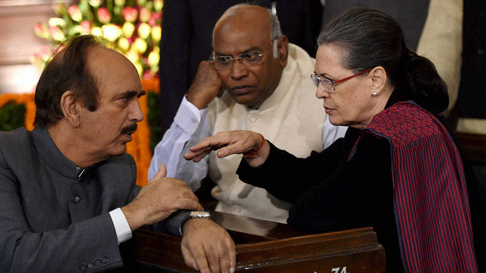 Congress President Sonia Gandhi with party leaders Mallikarjun Kharge and Ghulam Nabi Azad at Parliament House in New Delhi, November 19, 2015. (Photo: PTI)