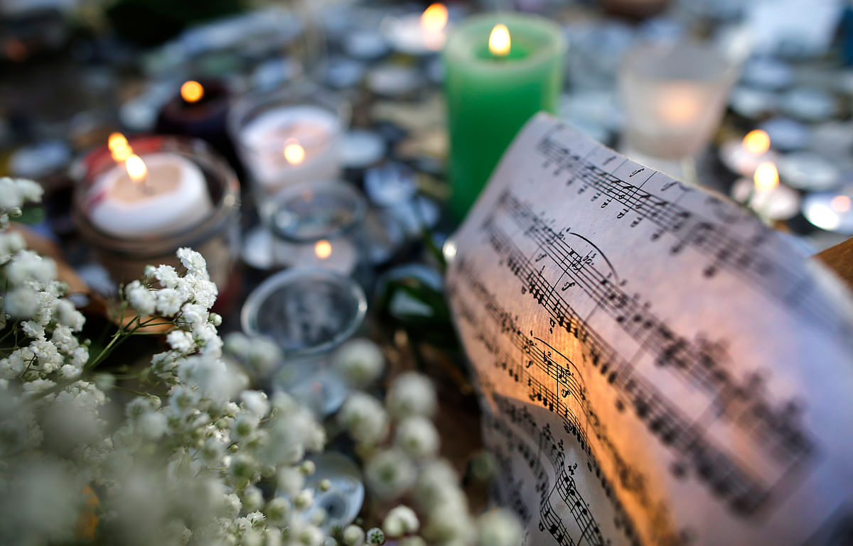 Sheet music is seen amongst candles near the site of the attack at the Bataclan concert hall in Paris, November 15, 2015. (Photo: Reuters)