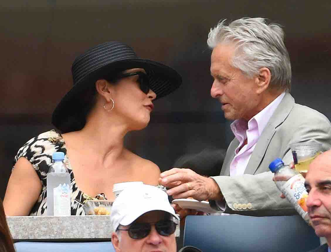 A candid moment between Douglas and Zeta Jones (Photo: Reuters)