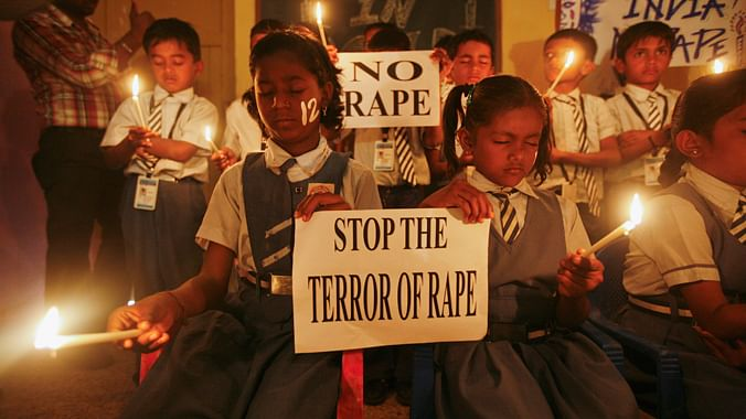 School children participate in a candle vigil, December 2012. (Photo: Reuters)