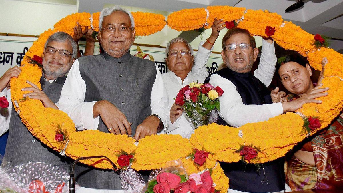 Bihar CM Nitish Kumar with RJD chief Lalu Prasad, JD(U) national president Sharad Yadav and Congress leader CP Joshi. (Photo: PTI)
