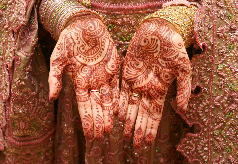 An Indian bride wearing red mehendi. (Photo: iStock)